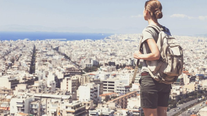 Traveler-Woman-Looking-Big-City-Travel