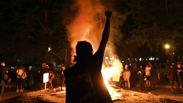 Portland-Riot-Protests-Fire-Fist-Raised